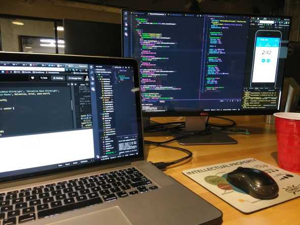 Laptop and monitor with code on the screens